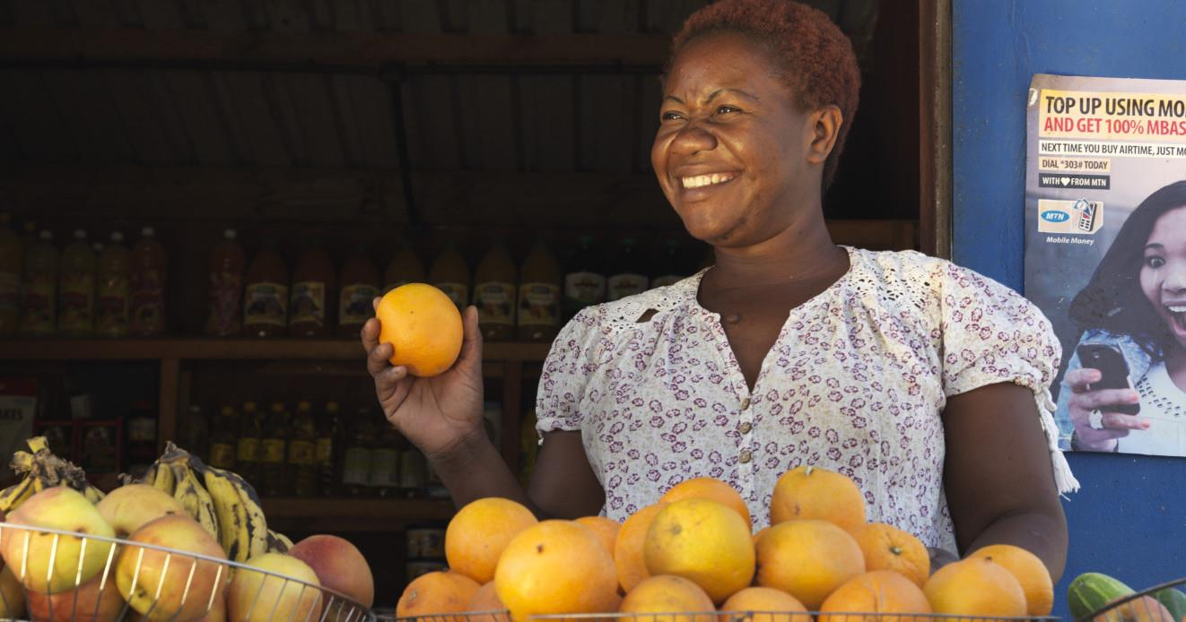 The women supported: My name is Dalphine Makanya, I'm 36 years old and belong to Chitukuko women's credit group in Kafue Zambia. Chitukuko means development. I'm married, my husband is Hector Mwale,45. He works as a delivery driver. We have 3 children together and I look after two other children. There are 7 of us living together in a rented three bedroomed house. I started school at 7 and dropped out at 18. We got married at 20 and I had my first child at 21 years. What I love about microloan foundation is the fair interest rate they offer, which is lower than other financial institutions I have worked with. Since I joined chitukuko women credit group, I have learnt how to save, calculate profit, loss, and costs. The money I'm saving is for building a shop at the market on the piece of land I bought. Before I got a loan from microloan foundation of k1, 000.00 (£82) I used to only sell groceries. Now I sell fruits and vegetables outside my shop. My husband also supports me and helps me when I face difficulties with my repayments.